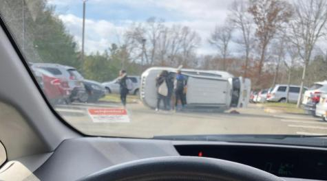 Flipped vehicle in Hill Top parking lot