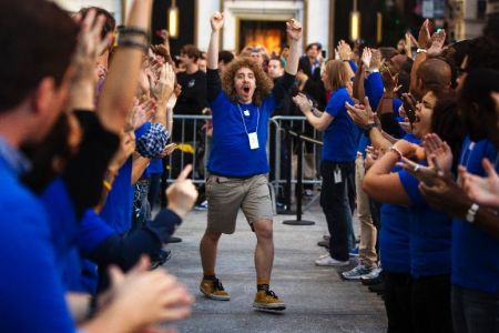 Apple employees celebrate the release of the Apple iPhone 5 phone outside of the Apple Store on 5th Avenue in New York.