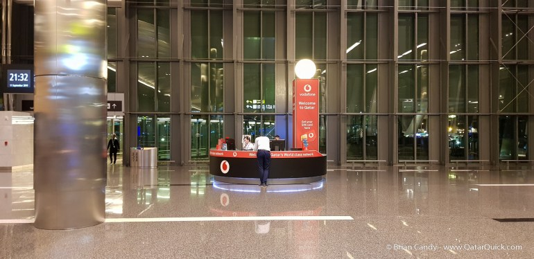 An image of the Vodafone sales kiosk within arrivals at Hamad International Airport