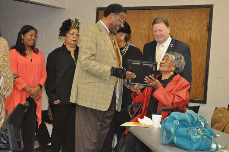 Breakfast Forum founder Sarah Stevenson, seated, presents a certificate to Johnson C. Smith University President Ronald Carter recognizing his work in the community, January 24, 2017. (Photo: Qcitymetro.com)
