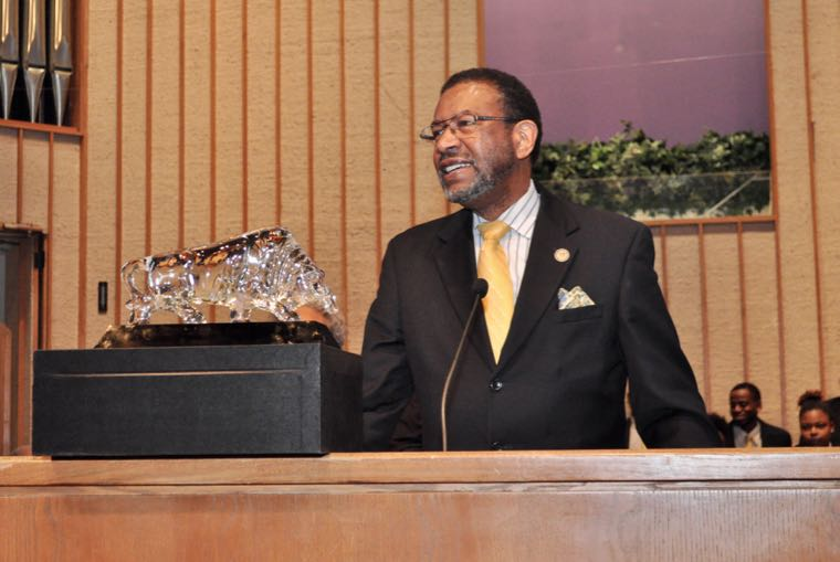 In recognition of his service to JCSU, the congregation of First Baptist Church-West gave President Ronald Carter a crystal shaped to resemble the school's Golden Bull mascot. (qcitymetro)