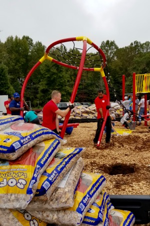 Foundation For The Carolinas staff helps build a playground at J.H. Gunn Elementary.