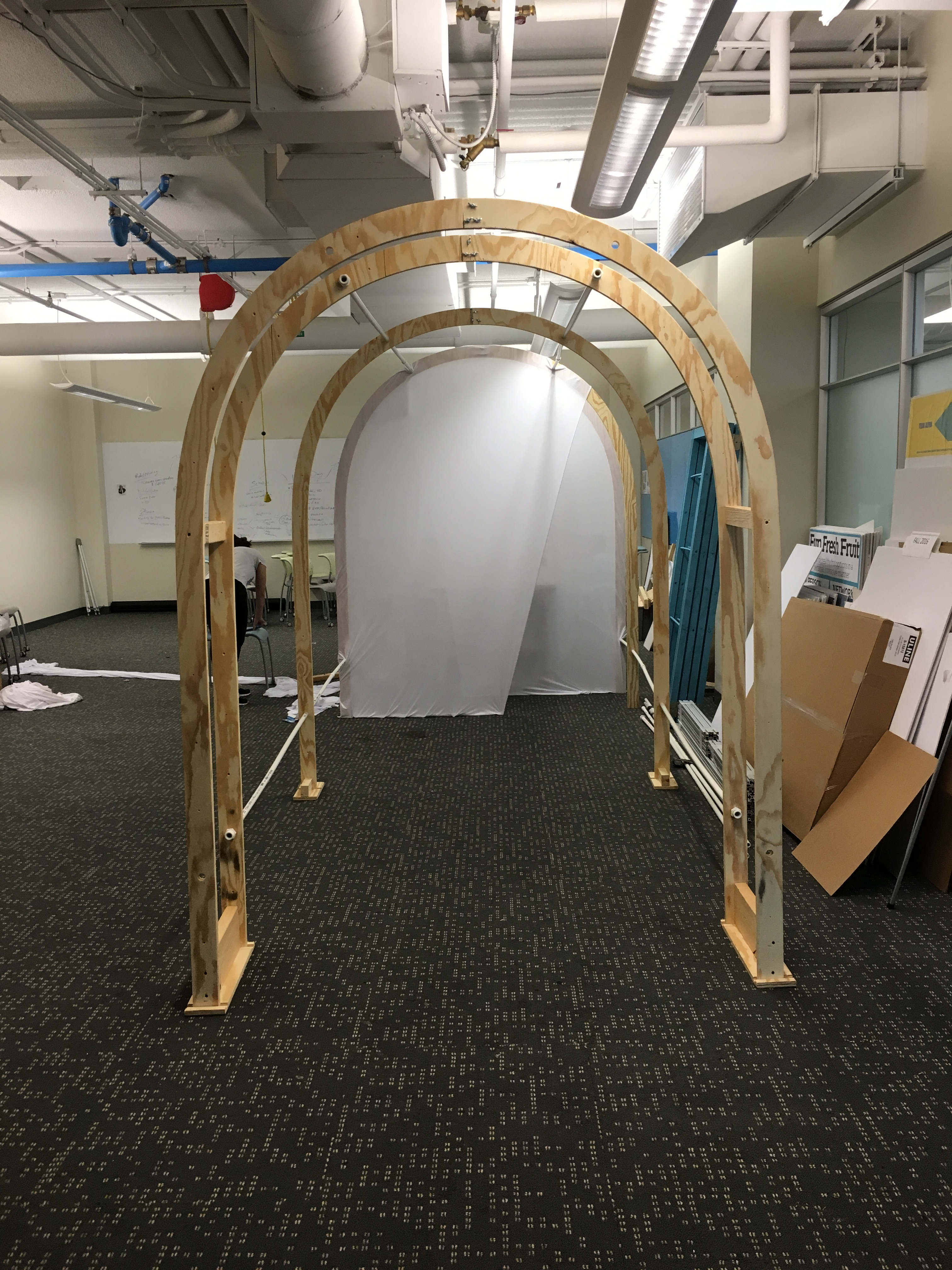 Beginning to add the fabric to the Tunnel frame - front view.