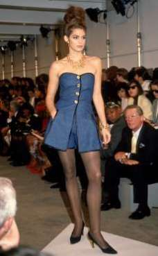 CINDY CRAWFORD Feeling blue! Crawford, now 51, strikes a pose at a 1991 Donna Karan fashion show. ©Barbara Rosen/IMAGES/Getty