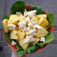 Vegan feta cheez recipe presented with a fresh salad with juicy pineapple and baby spinach
