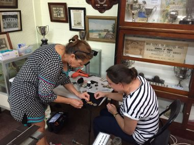 Sue and Melanie working on medal mounts
