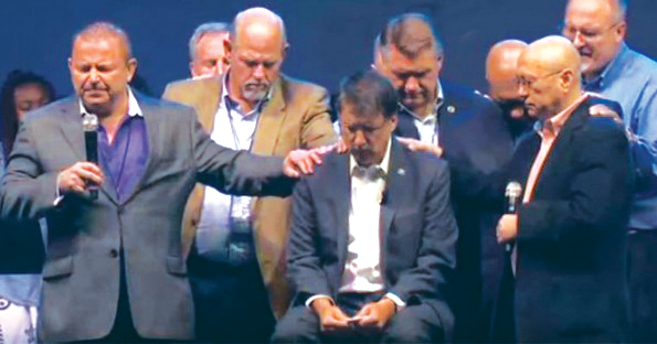David Lane and other religious leaders place hands on Gov. McCrory and pray at a rally held at the Charlotte Convention Center, Sept 26. Source: YouTube screen capture.