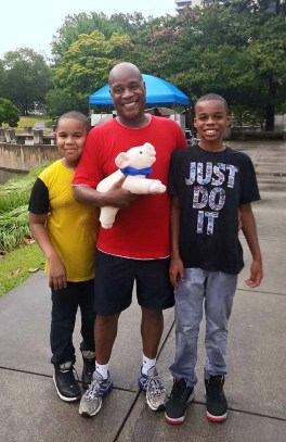 Milton Howard and his sons, Milton II and Connor, spend the day at PowerHouse in the Park, an HIV awareness event.