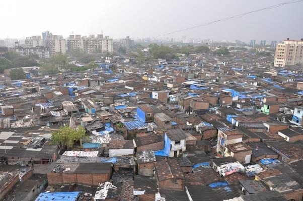 Who owns the land on which Slums are situated in Mumbai? Is it government owned and if yes why can't they acquire it to provide better living ...