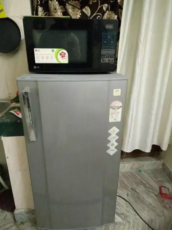 can i put microwave over fridge quora