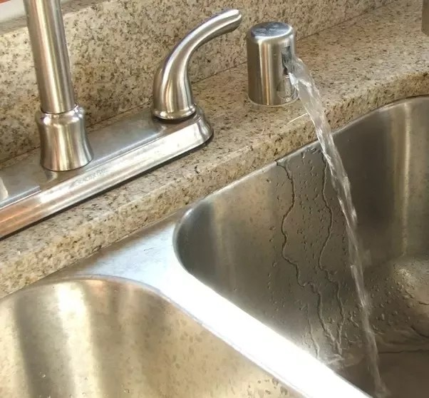 does my dishwasher drains into my sink
