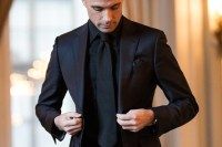 Is it appropriate to wear a black tie with a black suit ...