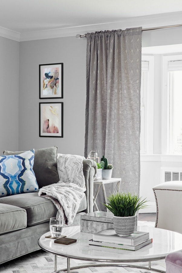 living room designs with grey walls corner table what color of curtains would go well a gray colored if you want to liven things up bit for set dramatic two tone colorblocked like this designer did because they knew that bedroom