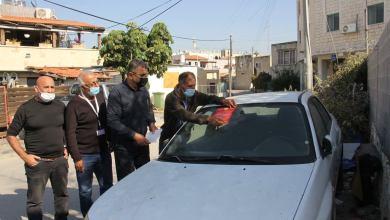 صورة حملة لإزالة السيارات المتروكه والمركونه على حواشي الطرقات والشوارع