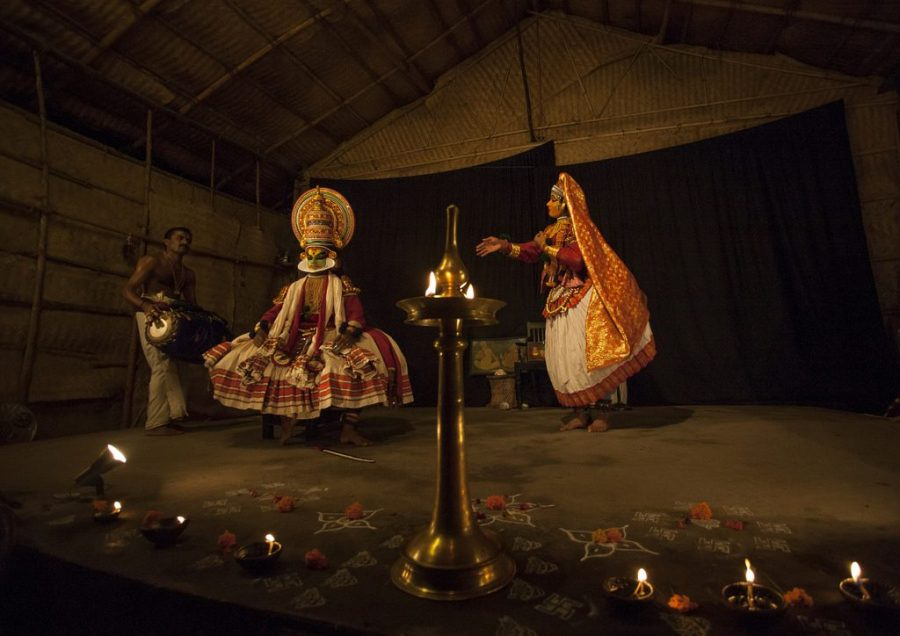 Movements of a Kathakali performance magnified by the use of long shadows cast by central wick lamp.