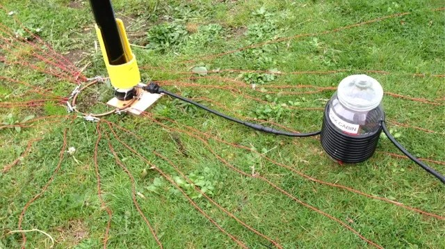 Choke balun and radial ring at the base of my 40m vertical