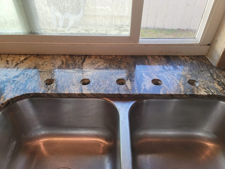 Repaired cracked granite