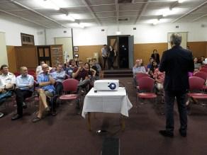 Q3 participants at the screening room listening to Der Derian. Photo: Gilbert Bel-Bachir.