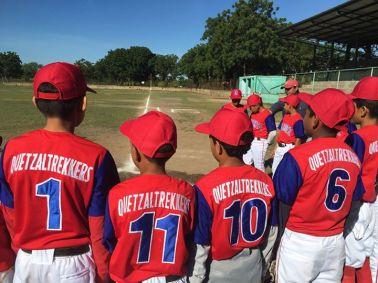 The boys baseball team wearing brand new uniforms