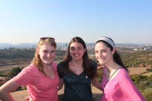 Alison, Jessica, & Jenna on top of Voortrekker Monument with Pretoria in background.