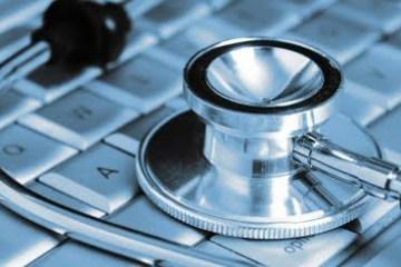 Salud y Estetoscopio sobre teclado
