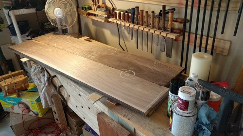 The four walnut boards upon the bench
