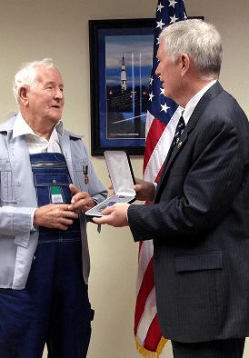 Congressman Brooks presents Mr. Selwyn Lamberth with Prisoner of War Medal.