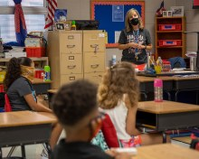 Forest Hills Elementary School fourth grade teacher Jennia Russell speaks with her students on the first day of school.
