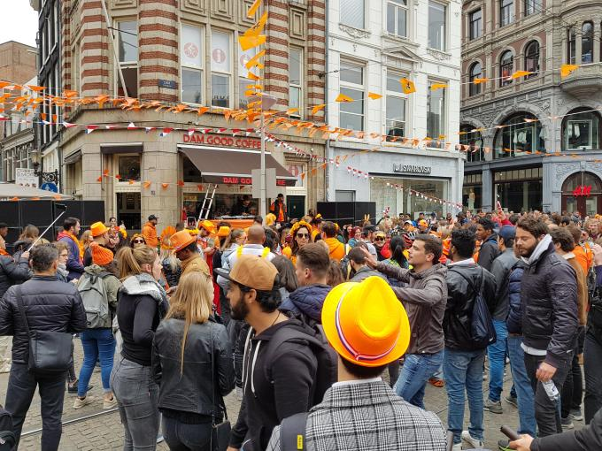 A party in Amsterdam's dam square with lots of people partying