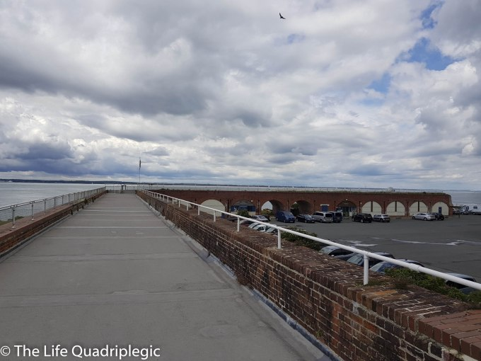 On the roof of Fort Victoria, a long thin building with low brick walls on the either side