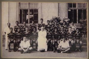 First ever Rugger Team of S. Thomas' College Mt. Lavinia 1955 1st XV Standing left to right : L.W. Abeywardena (Master-in-Charge), Rohantha de Silva, D.M. Seneviratne, Asoka Wickramanayake, Rodney Ingleton, Michael Tissera, T. Gray, R. Kandaiya, Tissa Molligoda. Seated left to right : P.B. Jayasekara, L. Hewawasam, Lester Shockman, K.S. Ananthan (Captain), Warden R.S. De Saram, S.B.L. Perera, Ifthikar Cader, Errol Jacotine, Dan Piachaud, Sudath Weerasuriya. On the ground : VanCuylenburg and Mack. Absent : Coach Mahesh Rodrigo.
