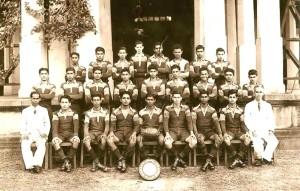 Trinity College 1st XV Rugger Team 1955 Standing 1st row Left to Right – U. Ratnayake, N. Maralanda, S.L. Ekanayake, R. Frank, C.G.P. Weerasinghe, S.P.de Silva, J.C.B. Dhanapala, L. Moonamale Standing 2nd row Left to Right – A. Pilimatalawa, R.B. Abeyakoon, R.T. de Sylva, E.C. Fernando, M.U. Odayar, G. Aludeniya, A.S.B Ellepola, R.N. De Alwis, Ken de Joodt Seated Left to Right – Mr. G.Y. Sahayam (Vice Principal), W. Bathazaar, F. Omar, N. de Soysa, .M.G. Ratwatte (Captain), D.N.Frank, F. Jacob, V. Boteju, Major H.A. Hardy (Coach).