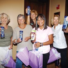 Door prize winners Adele Adams, Acthea Critchlow, Sandy Castle, Charlene Nilson and Linda Bishop show off their prunes.