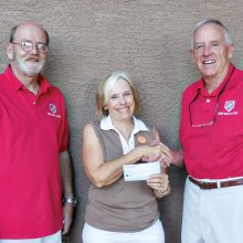 President of the Lady Putters Dee Waggoner presents donation check to Bob Atwater and Steve Abel from the Green Valley MOAA.