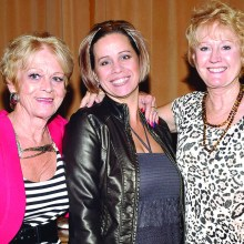 Presenter Tammi Graham (center), assisted by Nancy Anttonen and Diane Aitken, gave fashion advice to TWOQC.