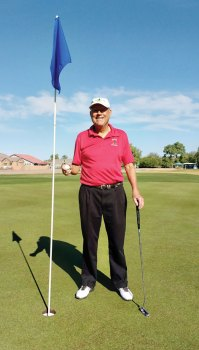 Ron Courson celebrates his hole-in-one during the Desert Duffer overnight golf outing to Casa Grande.