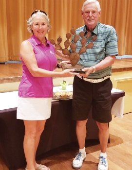 Tim Phillips, president of the QCMGA, presents Chris Gould, president of the QCLGA, the Prickly Pair Trophy.