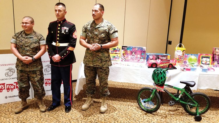 Marines from the Marine Corps Reserve Center in Tucson with some of the toys donated by members of Green Valley MOA; photo by John McGee
