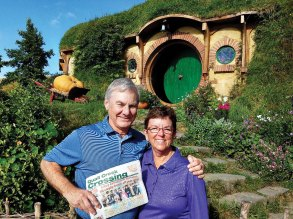Jim and Patty Hall enjoyed big smiles, short sleeves, sunny skies and blooming flowers on their trip to Bag End, The Shire, Middle Earth, New Zealand.