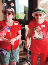 Emilie Ortega (left) and Fay Shapiro wore holiday headgear when they putted at Christmas in July. Photo by Sylvia Butler.