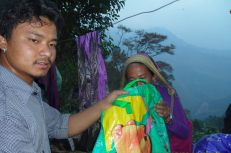 Butti received a bag of new mother supplies through Nehi Fund. Her house was destroyed by the quake but luckily the family managed to escape.