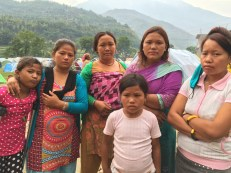 This family from Haku-9 (of three brothers) lost nine members. Some of them survived by digging themselves out of rubble. Bipana Tamang (2nd from left) is a single mother and lost her 8-yr-old son. Bipana's sis-in-law (centre) lost her son. Puja (front) lost her mother.