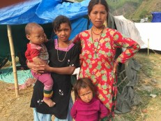 Prisana Tamang, 13, lost her sister, whose child she is holding in the picture.