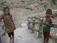 Shyam Bahadur Majhi's son (right) with a neighbour. Among his 12 children, only three live with Shyam Bahadur; the rest are being raised by relatives as Shyam Bahadur cannot support them.