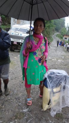 Sita Khadka, a single mother from Chilangkha VDC. The mini truck driver who had promised to give her a ride did not show up even till 10 pm. Her village was 3 hours' walk from Babare. She was not carrying any food or water. We gave her 500 rupees (through Nehi Fund) to buy some food. She spent the night in a tent.