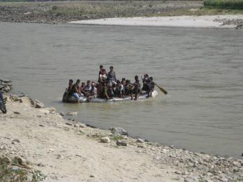 People from Chapadi village arrive at the collection point with other passengers