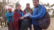 Handing over some clothes for local volunteers - sent by Numa Fudong from the UK, who has been actively involved in our relief work right from the beginning.