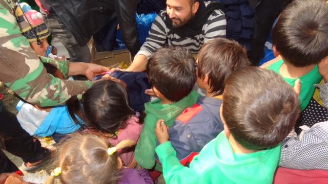 Nischal distributing clothes