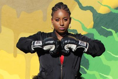 Qualah in Boxing gloves for weight