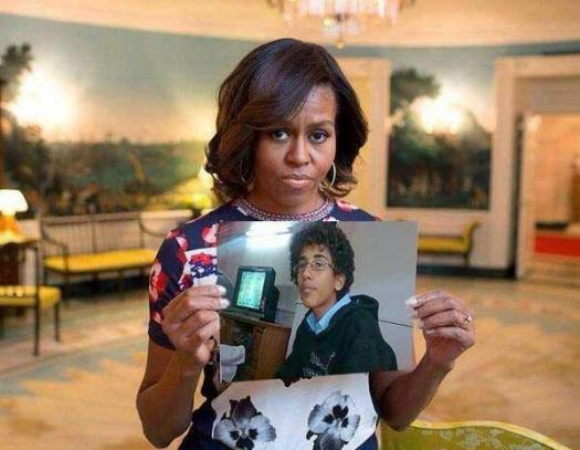 Michelle Obama Holds a Photo of Abdulrahman al-Awlaki